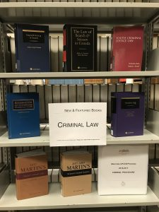 "A book display with eight books, on three levels of a bookcase. In the middle is a sign that says ""New and featured books: Criminal Law"". Book titles are in the blog post."